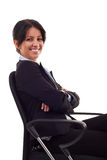 Woman sitting on office chair. Business woman sitting on office chair over white Stock Photo