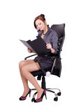 Woman sitting in office chair. A young girl with a folder in his hands sitting on a comfortable chair Royalty Free Stock Image