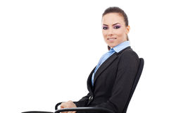 Woman sitting on office chair Royalty Free Stock Photography