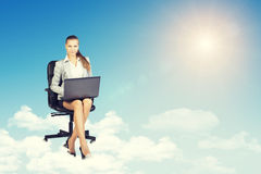 Woman sitting on office chair and holding open Stock Photo