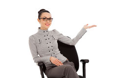 Woman sitting in office chair presenting something Royalty Free Stock Image