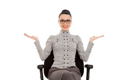 Woman sitting in office chair presenting something Royalty Free Stock Images
