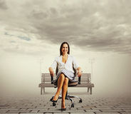 Woman sitting on the office chair Royalty Free Stock Photo