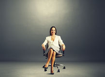 Woman sitting on the office chair Royalty Free Stock Photos