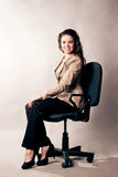 Woman sitting on a office chair Royalty Free Stock Image