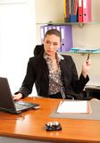 Woman sitting in the office in front of the laptop. Business woman sitting in the office in front of the laptop Royalty Free Stock Photo