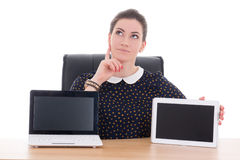 Woman sitting in office and showing laptop Royalty Free Stock Photo