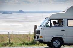 Woman sitting in old camper van stock image