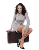 Woman is sitting on old leather case Royalty Free Stock Photos
