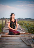 Woman in  sitting  on old wooden. Asia  woman in  sitting  on old wooden Royalty Free Stock Photo