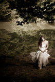 Woman Sitting On A Log, Desaturated Royalty Free Stock Photography