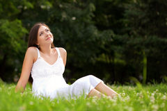 Woman Sitting On Grass Stock Photos