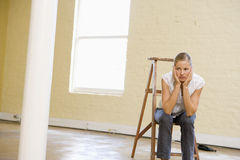 Woman Sitting On Ladder In Empty Space Royalty Free Stock Photography