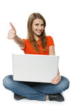 Woman Sitting On The Floor With Her Laptop Making Thumb Up Royalty Free Stock Photo