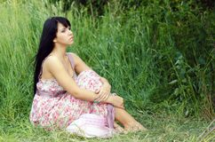 Free Woman Sitting On The Summer Meadow Stock Images - 105553414