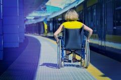 Free Woman Sitting On Wheelchair On A Platform Stock Photo - 158862870