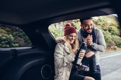 Couple having coffee break during road trip Royalty Free Stock Images