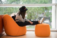 Woman Sitting on Orange Chair stock image