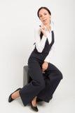 Woman sitting on ottoman Stock Image