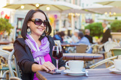Woman sitting in outdoor cafe Royalty Free Stock Images