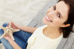 Woman sitting outdoors Royalty Free Stock Photos