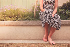 Woman sitting outside by lavender Stock Image