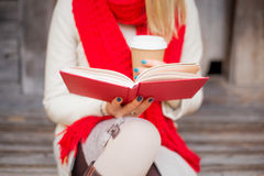 Woman sitting outside and reading royalty free stock photos