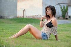 Woman Sitting Outside at Sunset Royalty Free Stock Photo