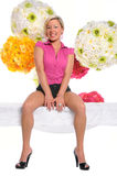 Woman Sitting Over Flower Background Stock Photos
