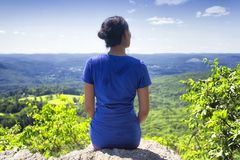 A woman sitting overlooking a landscape in connecticut royalty free stock image