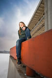 Woman sitting on parapet. Outdoor royalty free stock images