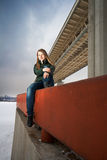 Woman sitting on parapet stock image