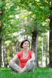 Woman sitting at the park Stock Images
