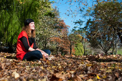 Woman sitting in the park Stock Photos