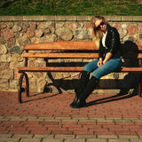 Woman sitting on the park bench Royalty Free Stock Image