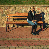 Woman sitting on the park bench Royalty Free Stock Photo