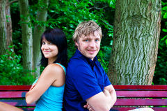 An and woman sitting on the park bench Stock Images