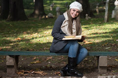 Woman Sitting In A Park And Reading Book Royalty Free Stock Images