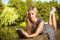 Woman sitting in park, relaxing and using phone Stock Photography
