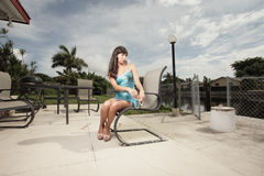 Woman sitting at the patio Royalty Free Stock Photos