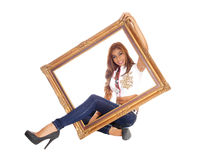 Woman sitting with picture frame. Stock Image