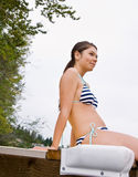 Woman sitting on pier Stock Image