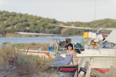 Woman Sitting on Pier Royalty Free Stock Image