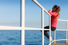 Woman sitting on pier looking at horizon outdoors Royalty Free Stock Photos