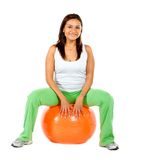 Woman sitting on a pilates ball Stock Images
