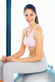 Woman sitting on pilates ball Stock Photos