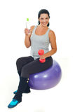 Woman sitting on pilates ball Royalty Free Stock Photos