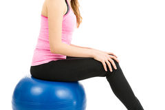 Woman sitting on pilates ball Royalty Free Stock Photography