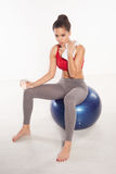 Woman sitting on a pilates ball Royalty Free Stock Photography