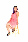 Woman sitting in pink dress. Royalty Free Stock Photo